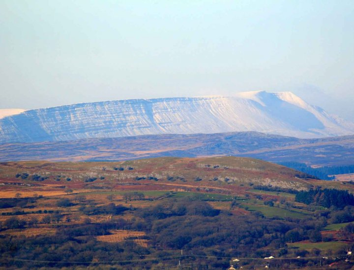 Penderyn and the snow topped Brecon Beacons beyond
