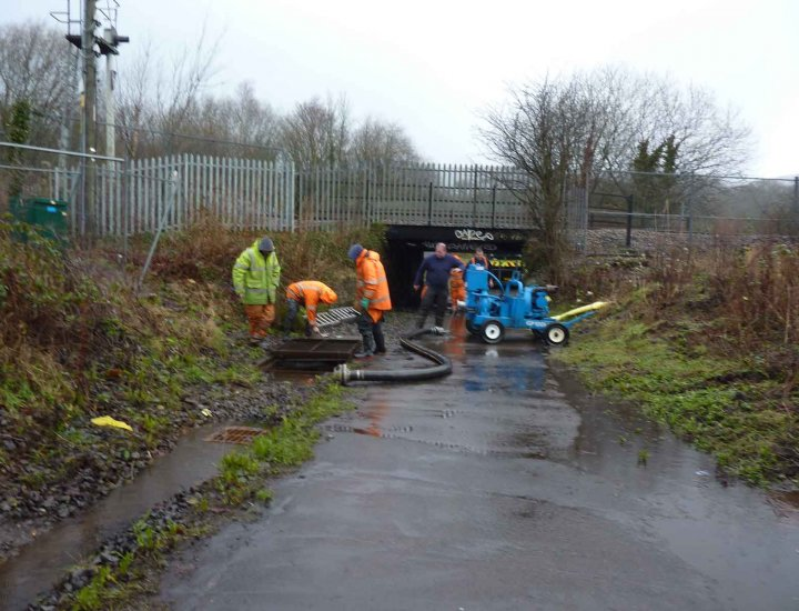 RCTC workmen at the Ynys pumping out floodwater