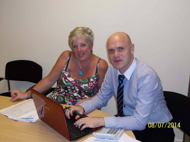 Jo Roe, proprietor of Tonypandy craft-making business Craft of Hearts, receives support from Community Accountancy Wales Community Accounts Assistant Shaun Biggs.